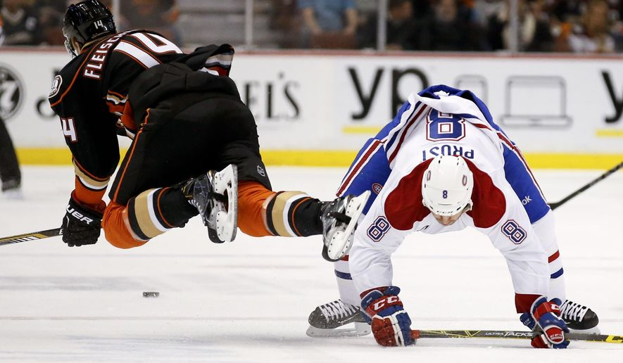 Montreal Canadiens right wing Brandon Prust, right, and Anaheim Ducks left wing Tomas Fleischmann collide during the first period of an NHL hockey game in Anaheim, Calif., Wednesday, March 4, 2015. (AP Photo/Chris Carlson)