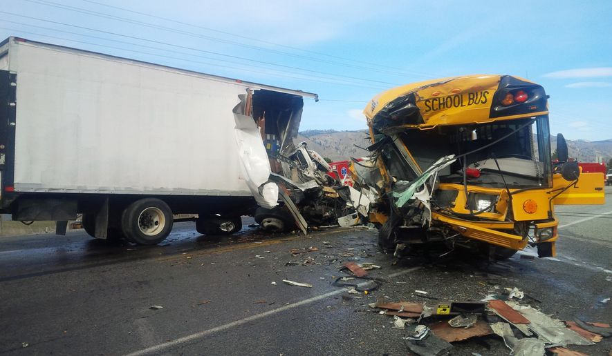 This photo provided by the Washington State Patrol shows the scene of an accident in which a motorist was killed and five students and others were injured in a crash involving a school bus, box truck and car near Orondo in Central Washington state Thursday, March 5, 2015. Two people in the truck were seriously hurt, according to the Washington State Patrol. Most injuries to the students and driver of the Orondo School District bus were minor, but one student may have a serious injury, Trooper Darren Wright said. (AP Photo/Washington State Patrol)