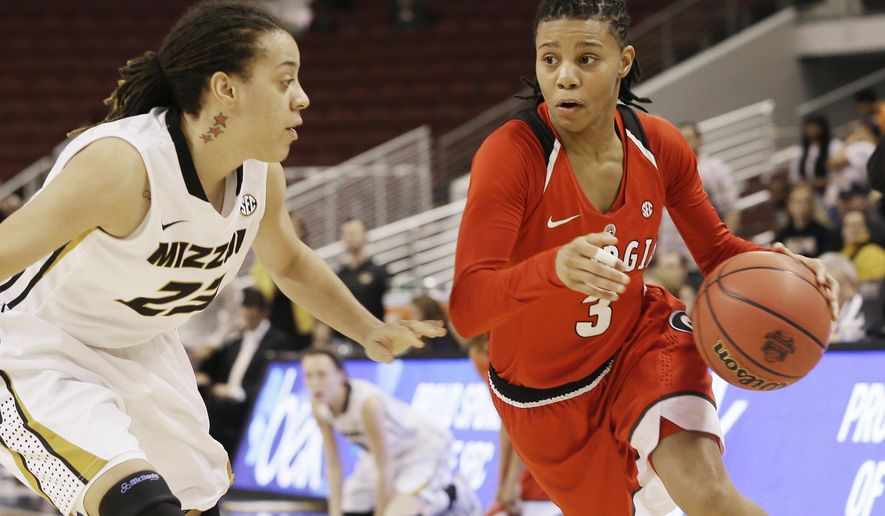 Georgia's Tiaria Griffin (3) takes the ball in front of Missouri's Juanita Robinson (23) in the second half of a Southeastern Conference women's tournament NCAA college basketball game in North Little Rock, Ark., Thursday, March 5, 2015. Georgia defeated Missouri 75-64. (AP Photo/Danny Johnston)