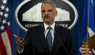 Attorney General Eric Holder speaks at the Justice Department in Washington on March 4, 2015, about the Justice Department's findings related to two investigations in Ferguson, Mo. (Associated Press) **FILE**