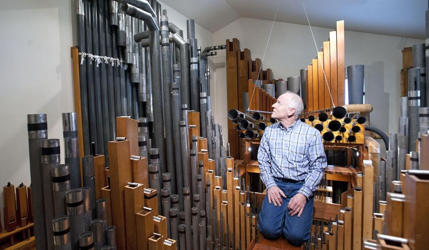 In a Friday, Oct.31, 2014 photo, Guy Vander Wagen sits in one of the two pipe rooms in a modest west side Grand Rapids, Mich. home. The former owner built a two-room addition the house so a 3200 pipe, wind powered pipe organ could be put inside. David Luttinen of Mountlake Terrace, Wa., hopes to move across the country so he can live in a Grand Rapids home containing a massive pipe organ. Luttinen says the church organ is the motivating factor for purchasing the bungalow.  (AP Photo/The Grand Rapids Press, Chris Clark) ALL LOCAL TELEVISION OUT; LOCAL TELEVISION INTERNET OUT