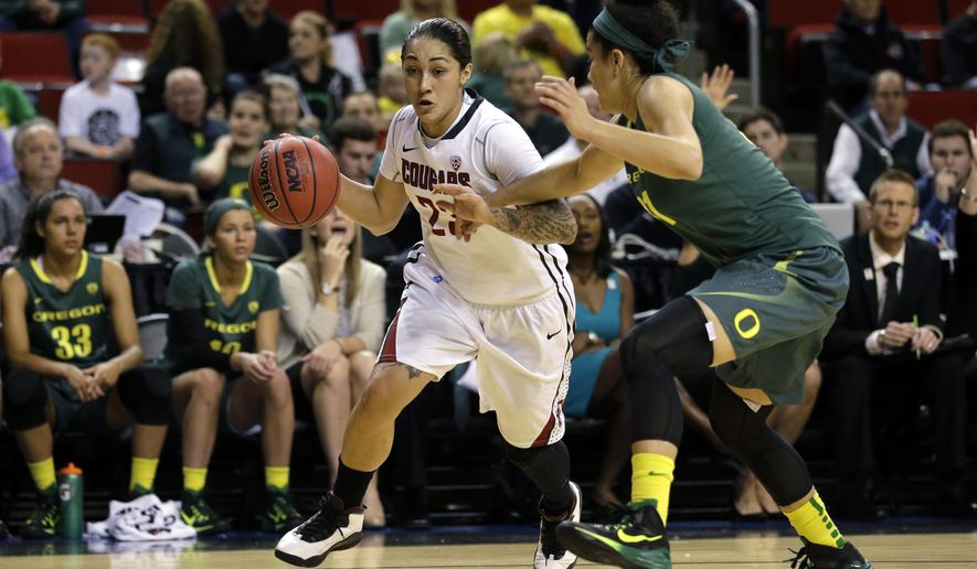 RETRANSMISSION TO CORRECT ID to LIA GALDEIRA - Washington State's Lia Galdeira, left, dribbles around Oregon's Katelyn Loper, right, in the first half of a first round NCAA college basketball game in the Pac-12 women's basketball tournament, Thursday, March 5, 2015, in Seattle. (AP Photo/Ted S. Warren)