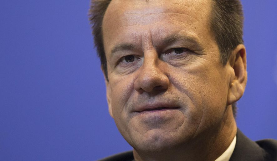 Brazil's soccer coach Dunga listens to questions during a news conference in Rio de Janeiro, Brazil, Thursday, March 5, 2015. Dunga summoned players for upcoming friendly games against France in Paris on March 26, and against Chile in London on March 29. (AP Photo/Felipe Dana)