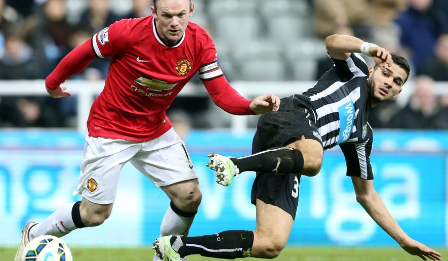 Manchester United's captain Wayne Rooney, left, vies for the ball with Newcastle United's Mehdi Abeid, right, during their English Premier League soccer match between Newcastle United and Manchester United at St James' Park, Newcastle, England, Wednesday, March, 4, 2015. (AP Photo/Scott Heppell)