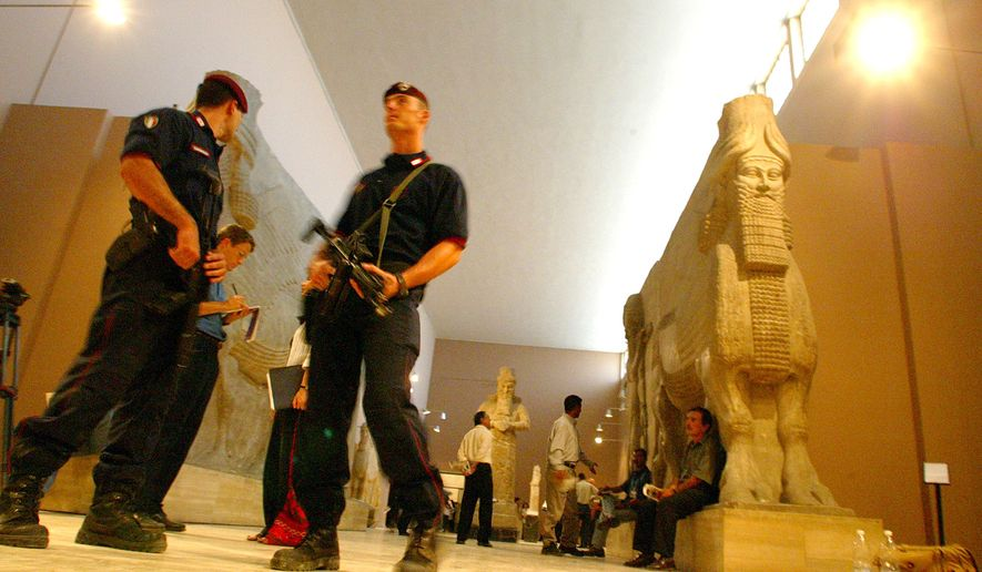 Italian Carabinieri keep alert as they guard the new exhibition of Iraqi treasures in the National Museum in Baghdad, on  Thursday, July 3, 2003. The Iraqi National Museum briefly opened its doors to the press Thursday. Looting at the museum provoked an international outcry after Baghdad fell on April 9, but U.S. occupation authorities say many of the museum's most important items  including the world-famous treasures of Nimrud  have been accounted for. Still, scores of items remain missing, said museum director Donny George. The museum won't open to the public for about two years, George said. (AP Photo/Mikhail Metzel)
