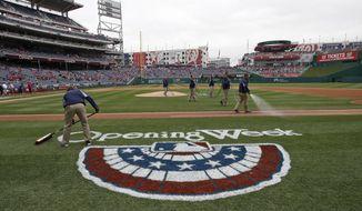 The field is readied before a baseball home opener between the Washington Nationals Atlanta Braves at Nationals Park Friday, April 4, 2014, in Washington. (AP Photo/Alex Brandon)
