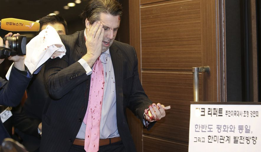 """[u'U.S. Ambassador to South Korea Mark Lippert leaves a lecture hall for a hospital in Seoul, South Korea, Thursday, March 5, 2015 after being attacked by a man. Lippert was in stable condition after a man screaming demands for a unified North and South Korea slashed him on the face and wrist with a knife, South Korean police and U.S. officials said Thursday.(AP Photo/Yonhap, Kim Ju-sung)  KOREA OUT', u'U.S. Ambassador to South Korea Mark Lippert placing his right hand on his face leaves a lecture hall for a hospital in Seoul, South Korea, Thursday, March 5, 2015 after being attacked by a man. Lippert was in stable condition after the man screaming demands for a unified North and South Korea slashed him on the face and wrist with a knife, South Korean police and U.S. officials said. The board at right reads: """"U.S. Ambassador to South Korea Mark Lippert\'s lecture."""" (AP Photo/Yonhap, Kim Ju-sung)  KOREA OUT']"""