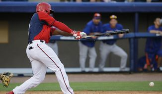 Washington Nationals' Denard Span breaks his bat as he hits to reach first base on a fielding error by New York Mets' Wilfredo Tovar in the third inning of an exhibition spring training baseball game, Thursday, March 5, 2015, in Viera, Fla. (AP Photo/David Goldman)