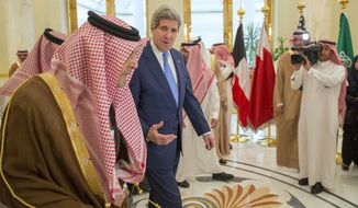 U.S. Secretary of State John Kerry, right, walks with Saud bin Faisal bin Abdulaziz Al Saud, Foreign Minister of Saudi Arabia, during a meeting of Gulf foreign ministers at Riyadh Air Base, on Thursday, March 5, 2015, in Riyadh, Saudi Arabia. Kerry planned to meet with Arab Gulf state allies in Riyadh Thursday before sitting down with the foreign ministers of France, Britain, and Germany in Paris on Saturday to share the state of the Iran nuclear negotiations. (AP Photo/Evan Vucci, Pool)