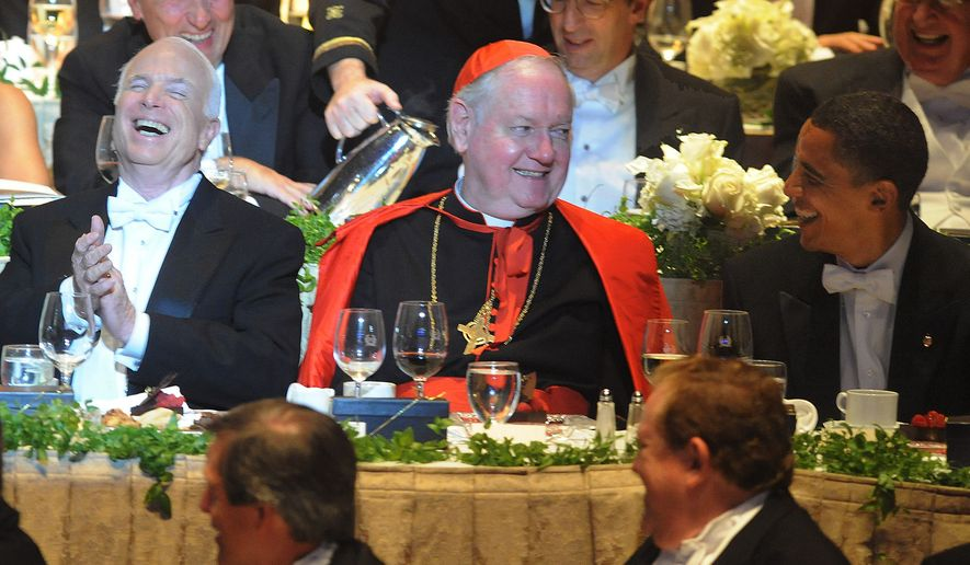 In this Oct. 16, 2008, file photo, New York Cardinal Edward Egan, center, joins candidates Sens. John McCain, left, and Barack Obama at the 63rd Annual Alfred E. Smith Foundation Dinner in New York. Egan, the former archbishop of New York, died, Thursday, March 5, 2015, of cardiac arrest in New York. He was 82. (AP Photo/Andrew Theodorakis, Pool, File)