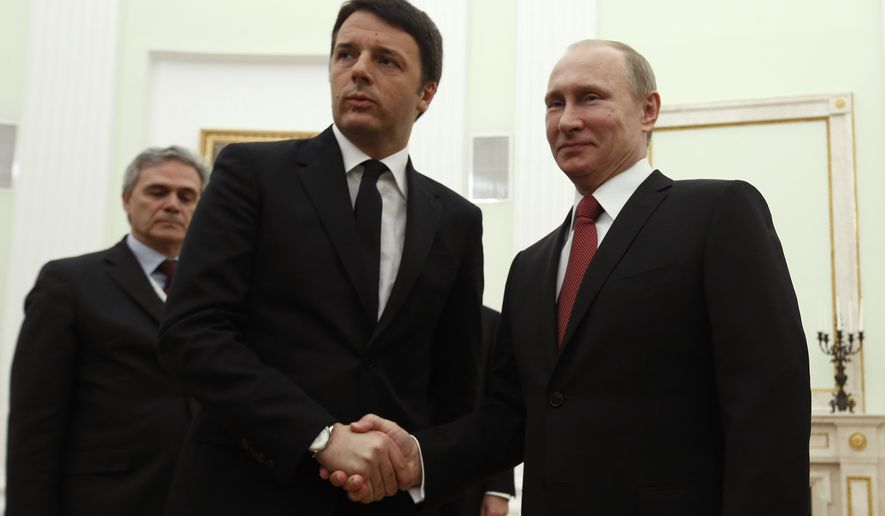 Russian President Vladimir Putin, right, shakes hands with visiting Italian Prime Minister Matteo Renzi, second left, in Moscow, Russia, Thursday, March 5, 2015.  (AP Photo/Sergei Karpukhin, pool)