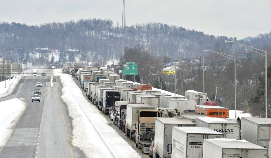 More than 50 miles of Interstate 65 southbound in Kentucky is shut down from the weather, Thursday, March 5, 2015, in Mt. Washington, Ky. Kentucky State Police has reported that the interstate will not reopen for 6-8 hours. Kentucky has been walloped by a winter storm that has dumped nearly two feet of snow in parts of the Bluegrass state. (AP Photo/Timothy D. Easley)