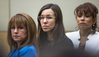 Convicted murderer Jodi Arias, center, watches jury enter courtroom before hearing their verdict Thursday, March 5, 2015, in Maricopa County Superior Court in Phoenix. Arias was spared the death penalty on Thursday after a jury for a second time could not decide on her punishment. (AP Photo/The Arizona Republic, Tom Tingle, Pool)