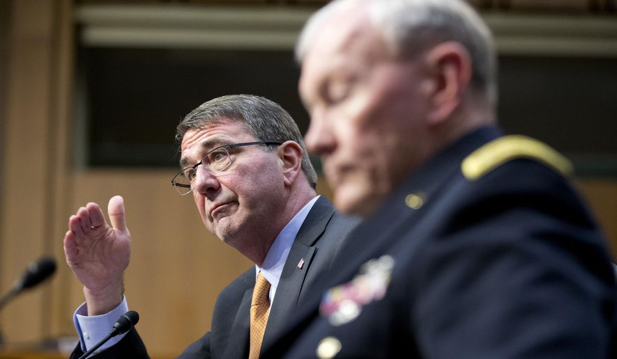 """FILE - In this March 3, 2015 file photo, Defense Secretary Ash Carter, left, accompanied by Joint Chiefs Chairman Gen. Martin Dempsey, testifies on Capitol Hill in Washington before the Senate Armed Services Committee. Iran's growing influence in Iraq is setting off alarm bells, and nowhere is the problem starker than in the high-stakes battle for Tikrit. It marks a crucial fight in the bigger war to expel the Islamic State group from Iraq, and yet Iran and the Shiite militias it empowers _ not the U.S. _ are leading the charge. Carter, under questioning from Sen. John McCain this week, acknowledged his concern when McCain asked if it alarms him that Iran """"has basically taken over the fight."""" (AP Photo/Manuel Balce Ceneta, File)"""
