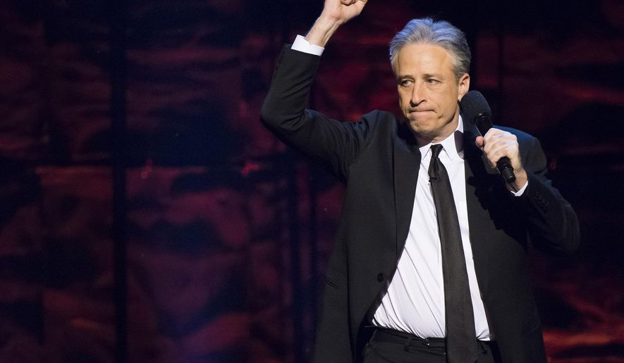 """FILE - In this Feb. 28, 2015 file photo, Jon Stewart hosts Comedy Central's """"Night of Too Many Stars: America Comes Together for Autism Programs"""" at the Beacon Theatre in New York. The telethon airing Sunday from 8 p.m. to 10 p.m. EDT, will raise money for autism educational programs. (Photo by Charles Sykes/Invision/AP)"""