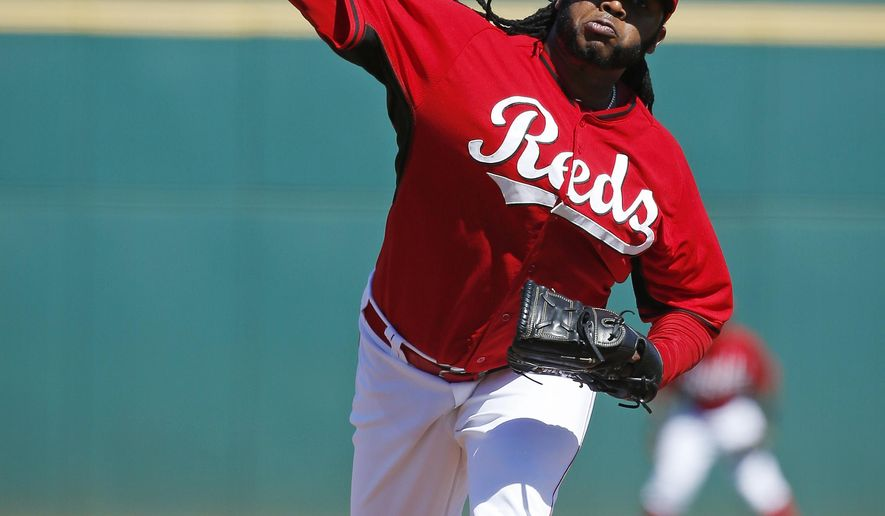 Cincinnati Reds' Johnny Cueto pitches in the first inning of a spring training exhibition baseball game against the Cleveland Indians, Thursday, March 5, 2015, in Goodyear, Ariz. (AP Photo/John Locher)