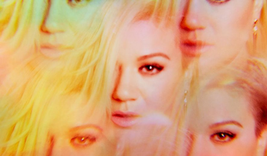 "This CD cover image released by RCA/19 shows ""Piece By Piece,"" the latest release by Kelly Clarkson. (AP Photo/RCA 19)"