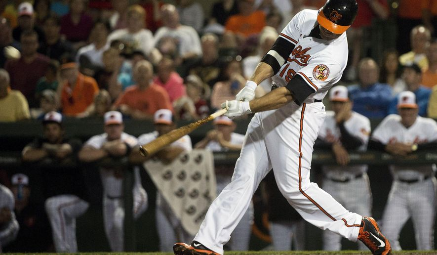 Baltimore Orioles first baseman Chris Davis (19) hits a a three run home run against the Toronto Blue Jays during the third inning of an exhibition baseball game Thursday, March 5, 2015 in Sarasota, Fla. (AP Photo/The Canadian Press, Nathan Denette)