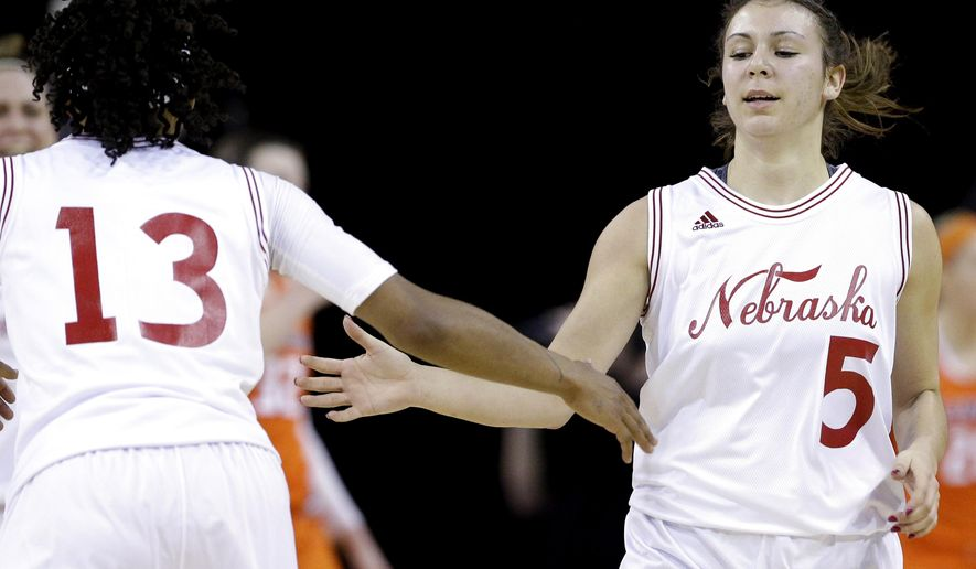 Nebraska guard Natalie Romeo, (5) celebrates with guard Brandi Jeffery after making a three point basket against Illinois during the first half of an NCAA college basketball game in the Big Ten women's tournament in Hoffman Estates, Ill., on Thursday, March 5, 2015. (AP Photo/Nam Y. Huh)