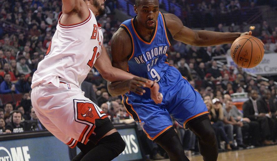 Oklahoma City Thunder forward Serge Ibaka (9) is defended by Chicago Bulls center Joakim Noah (13) during the first half of an NBA basketball game, Thursday, March 5, 2015 in Chicago.  (AP Photo/David Banks)