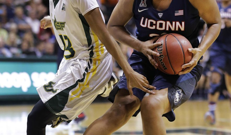 Connecticut forward Kaleena Mosqueda-Lewis (23) stops in front of South Florida guard Shalethia Stringfield (23) during the first half of an NCAA college basketball game Monday, March 2, 2015, in Tampa, Fla. Connecticut won 88-65. (AP Photo/Chris O'Meara)