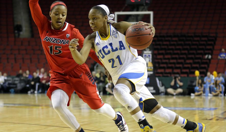UCLA guard Nirra Fields, right, drives around Arizona guard Keyahndra Cannon, left, in the first half of a first round NCAA college basketball game in the Pac-12 women's basketball tournament, Thursday, March 5, 2015, in Seattle. (AP Photo/Ted S. Warren)
