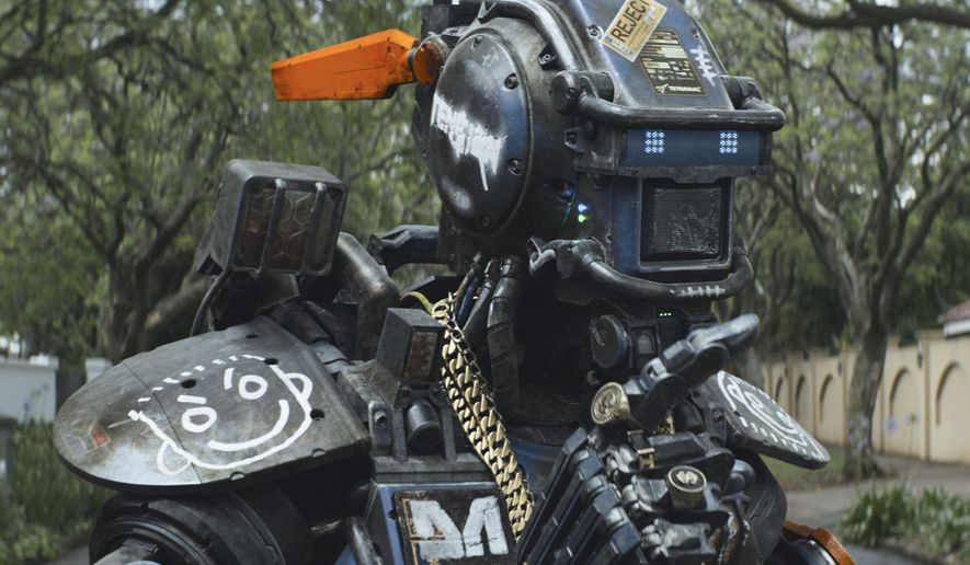 "This image released by Columbia Pictures shows the character Chappie in a scene from ""Chappie."" (AP Photo/Columbia Pictures)"