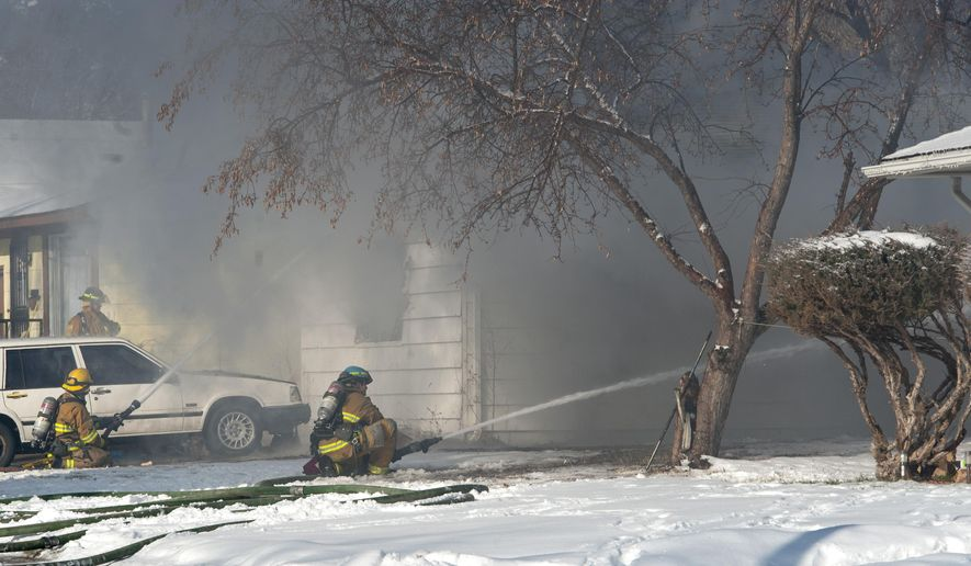 Colorado Springs firefighters battle a blaze at 2014 Tahoe Blvd. in Colorado Springs, Colo, Thursday, March 5, 2015. One person was found dead outside the home who died from other causes, not the fire.   (AP Photo/The Gazette, Christian Murdock)