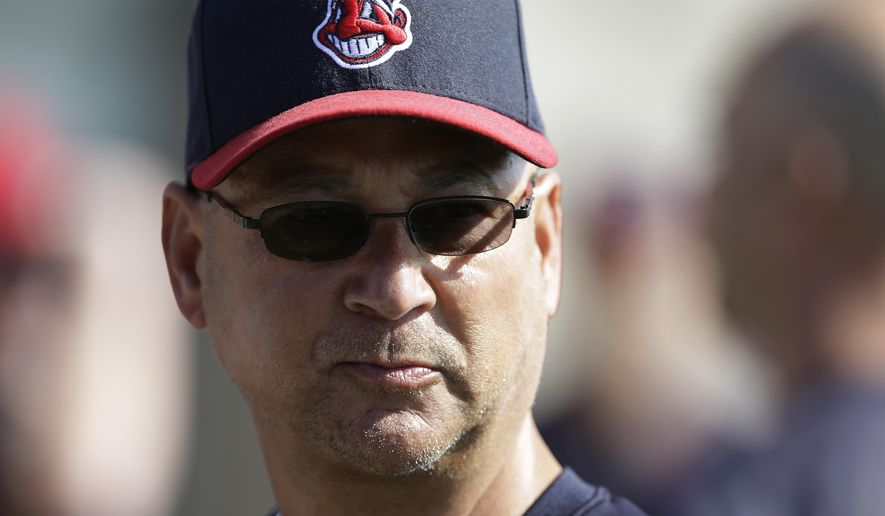 FILE - This Feb. 26, 2015 file photo shows Cleveland Indians manager Terry Francona (17) watching during spring training baseball practice in Goodyear, Ariz. The Indians have their first major injury of the spring _ Francona's red scooter is on the disabled list. Francona said Thursday, March 5, 2015 that the scooter he rides around during training camp and to and from Progressive Field in downtown Cleveland during the regular season was wrecked recently by a team employee during a promotional video shoot. (AP Photo/Darron Cummings, file)