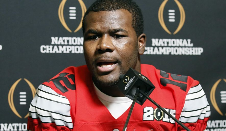 FILE - In this Jan. 10, 2015, file photo, Ohio State quarterback Cardale Jones (12) smiles as he responds to questions during media day for the NCAA college football playoff championship in Dallas. Two-time Big Ten player of the year Braxton Miller is still recovering from shoulder surgery. Last year's All-Big Ten quarterback, J.T. Barrett, is still on the mend from a broken ankle. So Cardale Jones, who led the Buckeyes to the Big Ten and national championships in three starts, should get a lot of snaps. (AP Photo/Tony Gutierrez, File)