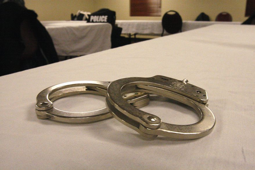 Handcuffs used on men arrested for prostitution solicitation sit on a table at a hotel in Minot, N.D., on Saturday, Jan. 31, 2015. Sex trafficking has become a big problem in North Dakota amid an oil boom that has brought in money and oil workers. (AP Photo/Martha Irvine) ** FILE **