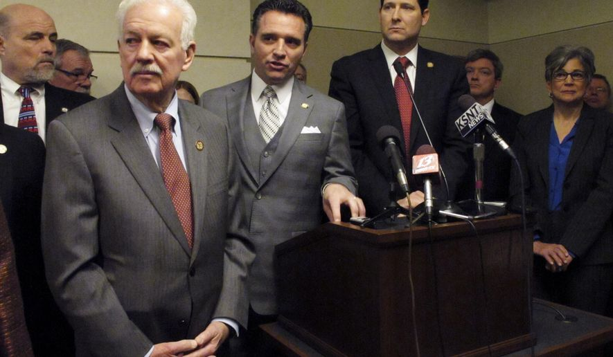 Kansas Senate Ways and Means Committee Chairman Ty Masterson, second from the left, an Andover Republican, discusses a new school funding plan during a news conference Thursday, March 5, 2015, at the Statehouse in Topeka, Kan. To his left is House Speaker Ray Merrick, a Stilwell Republican; to his immediate right is House Appropriations Committee Chairman Ron Ryckman Jr., an Olathe Republican, and to the far right is Senate President Susan Wagle, a Wichita Republican. (AP Photo/John Hanna)