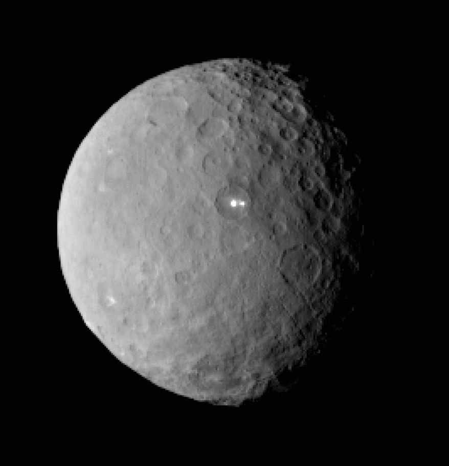 This Feb. 19, 2015, file image provided by NASA shows the dwarf planet Ceres, taken by the space agency's Dawn spacecraft from a distance of nearly 29,000 miles (46,000 kilometers). On Friday, March 6, 2015, NASA's Dawn spacecraft arrives at the mysterious dwarf planet located in the asteroid belt between Mars and Jupiter after a nearly eight-year journey. (AP Photo/NASA/JPL-Caltech/UCLA/MPS/DLR/IDA, File)