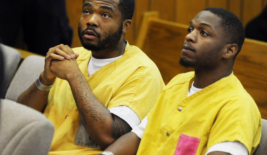 FILE- In a July 16, 2014 file photo, Raphael Hearn, left, and Raymone Jackson sit in court in Inkster, Mich, for a hearing in the case of the execution-style fatal shooting of 2-year-old Kamiya Gross. A Wayne County Circuit Court jury found Jackson guilty Thursday, March 5, 2015, of first-degree murder of Gross. The jury also convicted Hearn of first-degree murder. Prosecutors say Hearn helped Jackson plan and carry out the attack. (AP Photo/The Detroit News, Charles V. Tines, File, Pool)