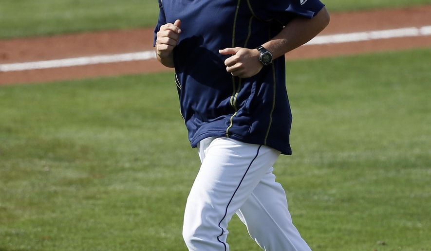 Tampa Bay Rays manager Kevin Cash jogs back to the dugout after making a pitching change in the ninth inning of a spring training baseball game against the Baltimore Orioles in Port Charlotte, Fla., Thursday March 5, 2015. The Orioles won 3-2. (AP Photo/Tony Gutierrez)