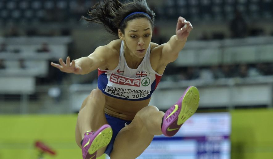 Britain's Katarina Johnson-Thompson makes an attempt in the long jump of the women's heptathlon at the European Athletics Indoor Championships in Prague, Czech Republic, Friday, March 6, 2015. (AP Photo/Martin Meissner)