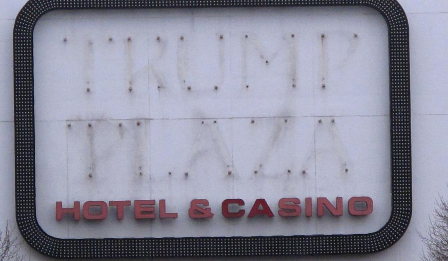"""This Jan. 14, 2015 shows the outline of letters that once spelled out """"Trump Plaza"""" on the facade of the former casino in Atlantic City N.J.  On Friday, March 6, 2015, Trump Entertainment Resorts appealed a bankruptcy court order in favor of Donald and Ivanka Trump allowing them to move forward with their lawsuit in New Jersey state court seeking to force the company to strip the Trump name from the rest of Trump Plaza and all of the Trump Taj Mahal. (AP Photo/Wayne Parry)"""