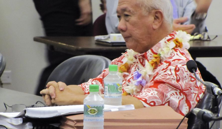 FILE- In this Feb. 13, 2015 file photo, Hawaii Rep. Calvin Say appears at a hearing in Honolulu. The Hawaii House voted Friday, March 6, 2015, to keep Say, one of its longest-serving members, after a first-of-its-kind special committee recommended that he stay. The House determined in a voice vote that Say is qualified to serve following a challenge over whether he lives in the district he represents. The case marked the first time Hawaii history that a legislative panel was formed to decide whether a representative had the qualifications to serve. (AP Photo/Cathy Bussewitz, File)