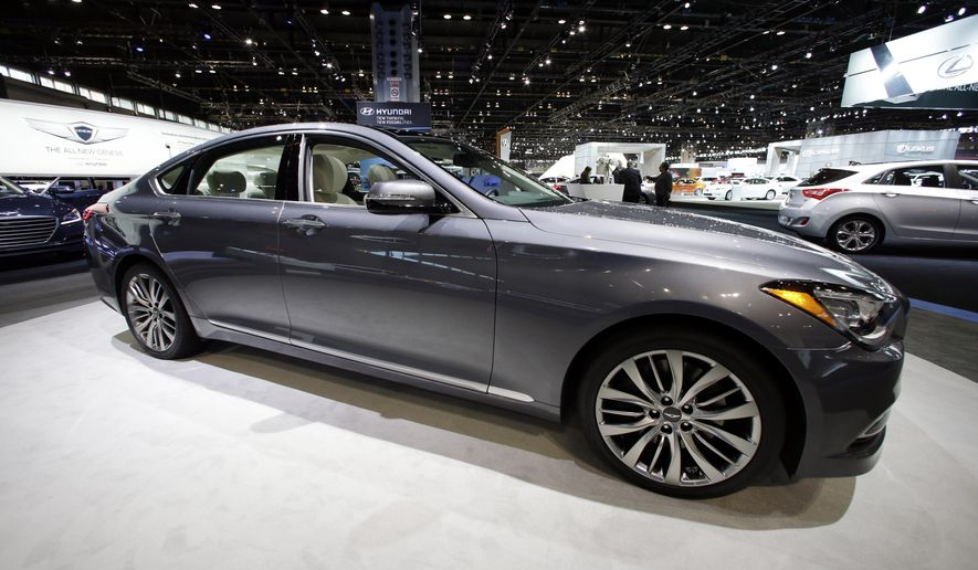 In this Friday, Feb. 7, 2014 photo, the Hyundai 2015 Genesis is displayed during the media preview of the Chicago Auto Show at McCormick Place, in Chicago. Hyundai announced, Friday, March 6, 2015, that the company is recalling more than 26,000 Genesis luxury cars from the 2015 model year in the U.S. and Canada to fix a water leak that can cause the transmission gear shifter to malfunction. (AP photo/Nam Y. Huh)