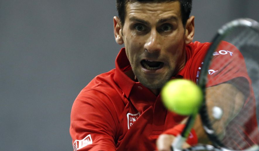 Novak Djokovic of Serbia returns the ball against Croatia's Mate Delic during their Davis Cup World Group first round tennis match between Serbia and Croatia, in Kraljevo, Serbia, Friday, March 6, 2015. (AP Photo/Darko Vojinovic)
