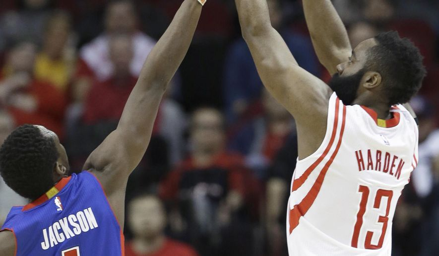 Houston Rockets' James Harden (13) takes a shot over Detroit Pistons' Reggie Jackson (1) in the first half of an NBA basketball game Friday, March 6, 2015, in Houston. (AP Photo/Pat Sullivan)