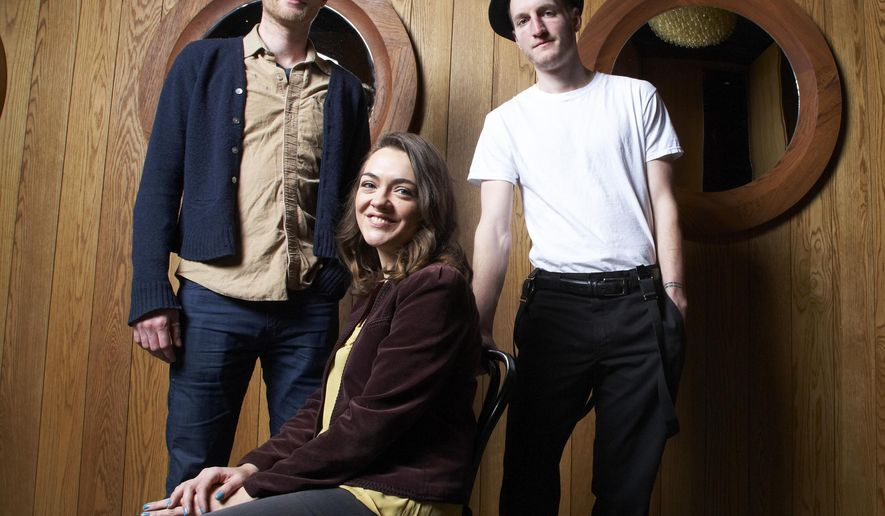 """FILE - In this Jan. 18, 2013 file photo, from left, Wesley Schutlz, Neyla Pekarek and Jeremiah Fraites of The Lumineers pose at the Dream Downtown Hotel in New York. Fraites says that a picture of a New Jersey newspaper columnist is the secret to the bands' success. He posted a picture of his keyboard with the picture of The Record political columnist Herb Jackson to the folk rock band's Facebook, Instagram and Twitter accounts on Thursday, March 6, 2015. He says that he taped the picture to his keyboard 10 years ago and that """"looking at him assures me creativity will flow.""""  (Photo by Dan Hallman/Invision/AP, File)"""