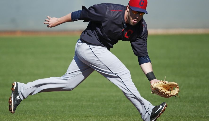 Cleveland Indians' Jason Kipnis participates in a drill during a workout before a spring training exhibition baseball game against the Cincinnati Reds, Thursday, March 5, 2015, in Goodyear, Ariz. (AP Photo/John Locher)