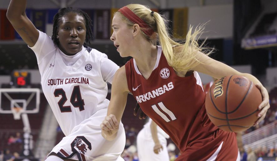 South Carolina's Aleighsa Welch (24) defends against Arkansas' Calli Berna (11) in the first half of a Southeastern Conference women's tournament NCAA college basketball game in North Little Rock, Ark., Friday, March 6, 2015. (AP Photo/Danny Johnston)