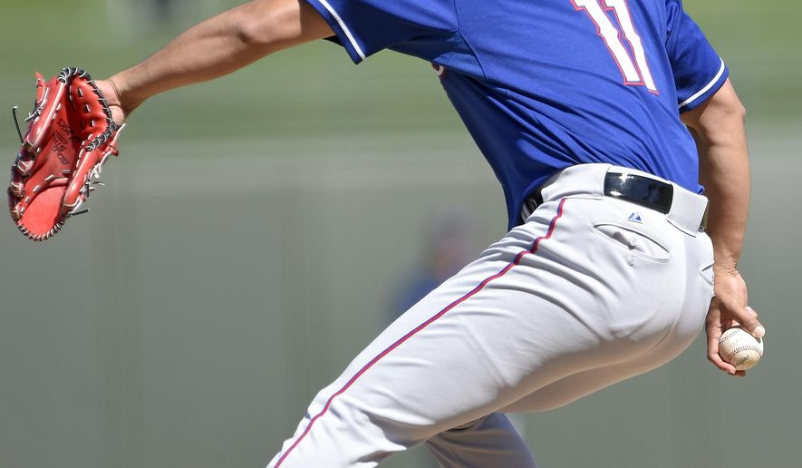 Texas Rangers pitcher Yu Darvish throws in the first inning against the Kansas City Royals in a spring training baseball game Thursday, March 5, 2015, in Surprise, Ariz. (AP Photo/The Kansas City Star, John Sleezer)
