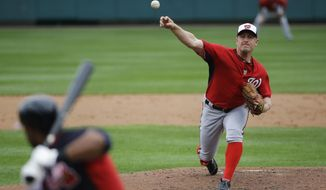 Washington Nationals starting pitcher Jordan Zimmermann, right, throws to Atlanta Braves' Zoilo Almonte in the second inning of an exhibition spring training baseball game, Friday, March 6, 2015, in Kissimmee, Fla. (AP Photo/David Goldman)