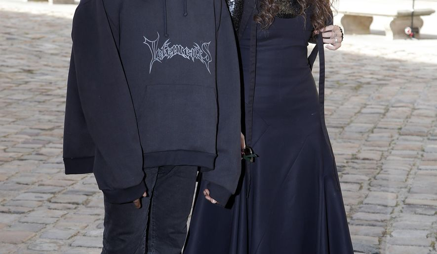 Kanye West and singer Lorde pose together when they arrive at Christian Dior's fall-winter 2015-2016 fashion collection, as part of Paris Fashion Week, presented in Paris, France, Friday, March 6, 2015. (AP Photo/Thibault Camus)
