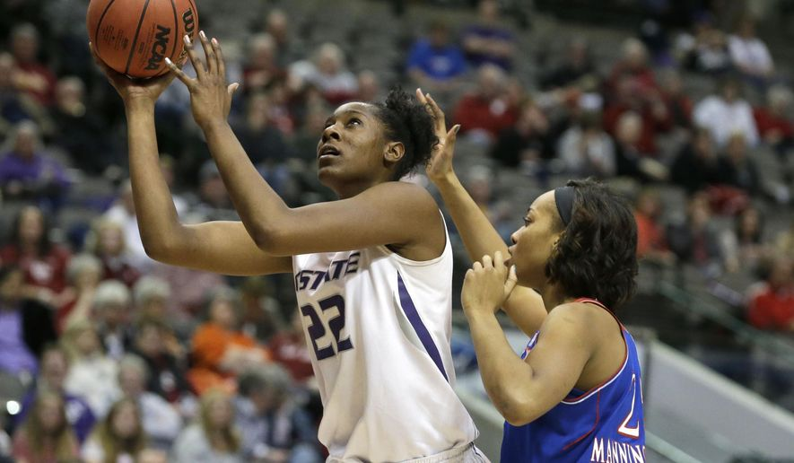 Kansas State forward Breanna Lewis (22) shoots against Kansas forward Caelynn Manning-Allen (25) during the second half of an NCAA college basketball game in the first round of the Big 12 Conference tournament Friday, March 6, 2015, in Dallas. Kansas State won 57-49.  (AP Photo/LM Otero)