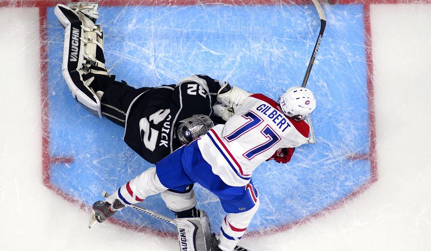 Montreal Canadiens defenseman Tom Gilbert, right, scores on Los Angeles Kings goalie Jonathan Quick during the second period of an NHL hockey game, Thursday, March 5, 2015, in Los Angeles. (AP Photo/Mark J. Terrill)