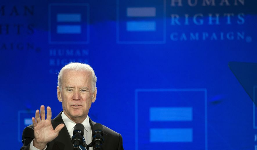 Vice President Joe Biden addresses the Human Rights Campaign Spring Equity Convention in Washington, Friday, March 6, 2015. Biden said the same human rights that African Americans fought for in Selma, Alabama, are at stake for gay rights activists today. Biden is drawing parallels between the civil rights and gay rights movements in a speech to the Human Rights Campaign, a gay rights group. (AP Photo/Cliff Owen)